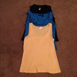 Three sleeveless professional work top bundle